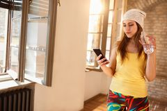 Girl looking on cell phone indoor Royalty Free Stock Photo