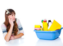 Girl looking at chemical detergents Royalty Free Stock Photos