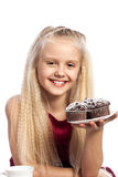 Girl looking at chocolate muffins Royalty Free Stock Photography