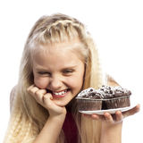 Girl looking at chocolate muffins Royalty Free Stock Image