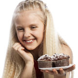 Girl looking at chocolate muffins Royalty Free Stock Photos