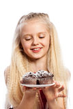 Girl looking at chocolate muffins Stock Photography
