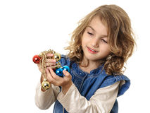 Girl looking at Christmas decorations beads Royalty Free Stock Photo