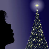 Girl looking a christmas tree. Contour of a little girl looking at one christmas tree in the night Royalty Free Stock Image