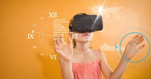 Girl looking at clock seen through VR glasses. Digital composite of Girl looking at clock seen through VR glasses Stock Photos