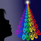 Girl looking colorful christmas tree. Illustration on little girl looking a colorful christmas tree with star in the night Royalty Free Stock Image