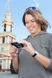 Girl looking at compact camera screen Stock Image