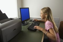 Girl looking at computer Royalty Free Stock Images