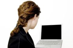Girl looking at computer. Photo of girl looking towards comuter Royalty Free Stock Photography