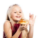 Girl looking at croissant Stock Photos