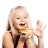 Girl looking at croissant Royalty Free Stock Photos