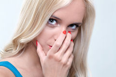 Girl looking. Cute girl looking with hand across face Stock Images