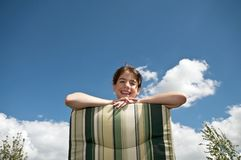 Girl looking from deck chair Royalty Free Stock Photos
