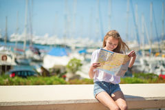 Girl looking for direction in Cannes, France Stock Image