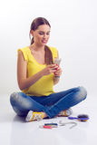 Girl looking disgustingly in mobile phone. On a white background Royalty Free Stock Photos