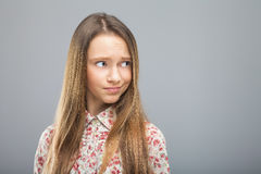Girl looking disregard at something. Young blond pretty girl in hipster shirt looking disregard at something. Concept of disrespect, negation, rejection Royalty Free Stock Photography
