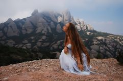 Girl looking into the distance. In the mountains of Montserrat stock photos