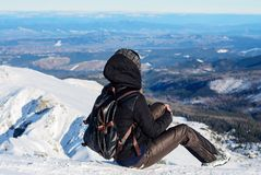 Girl looking into the distance on a mountaintop Royalty Free Stock Photos