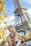 Girl looking into distance while sitting on parapet in Paris Stock Photos