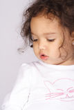 Girl looking down. An african american toddler girl looking down Stock Photography