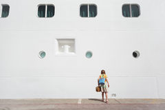 Girl looking down near passenger liner Stock Photos