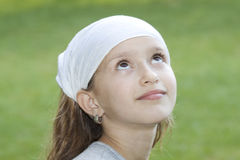 Girl looking dreamy Royalty Free Stock Image