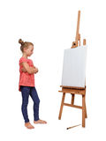 Girl looking on easel Stock Images