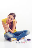 Girl looking at electronics cigarette. On a white background Royalty Free Stock Images