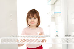 Girl looking in empty fridge Royalty Free Stock Photos