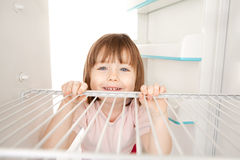 Girl looking in empty fridge Stock Image