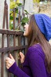 Girl looking through fence Royalty Free Stock Photography