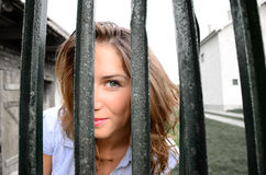 Girl looking through the fence Royalty Free Stock Images