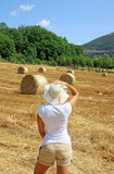 Girl in a tuscany field Stock Photography