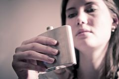 Girl looking at flask Stock Photo
