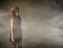Girl looking in a foggy room stock photography