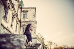 Girl looking forward in old castle Royalty Free Stock Photography