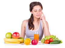 Girl looking at fruits and vegetables on the table Stock Photography