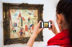 Girl looking at Fulla's painting, Slovakia royalty free stock image