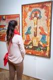 Girl looking at Fulla's painting, Slovakia royalty free stock photography