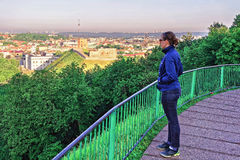 Girl looking at Gediminas Tower and Lower Castle in Vilnius Stock Images