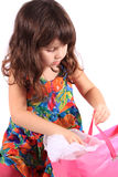 Girl looking in gift bag Royalty Free Stock Photography
