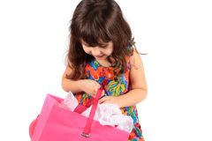 Girl looking in gift bag Royalty Free Stock Photo