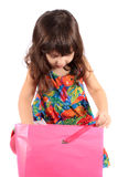 Girl looking in gift bag Royalty Free Stock Image
