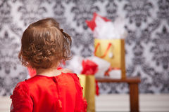 Girl looking at gift bags Royalty Free Stock Photography