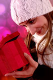 Girl looking into gift Royalty Free Stock Photography