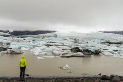 Girl looking at glacier lagoon near Skaftafell Stock Images