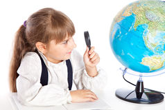 A girl is looking at the globe Stock Images