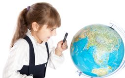 A girl is looking at the globe Stock Image