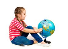 Girl looking at globe Stock Images