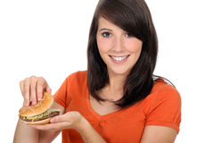 Girl looking at a hamburger Stock Photo